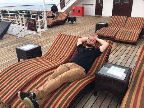 Ben sunbathing on deck